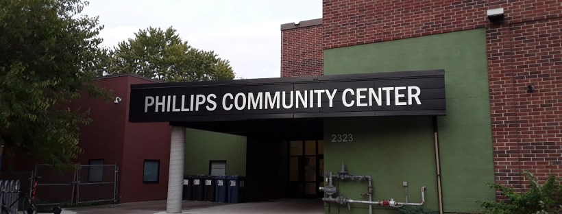 Photograph of the entrance to the Phillips Community Center, home of the Phillips Fitness Center, in Minneapolis, MN, where Marie Kube will be volunteering to teach a Zumba® dance fitness class on Mondays at 6-7 pm.