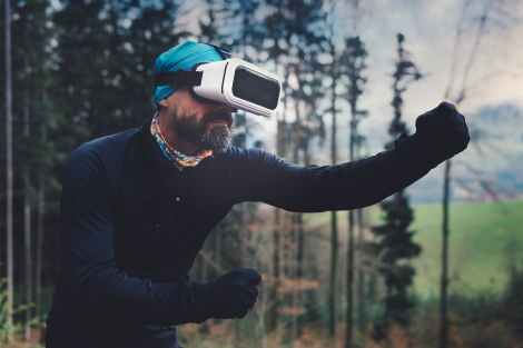 person wearing black henley shirt and white vr goggles, metaphor for spiritual growth