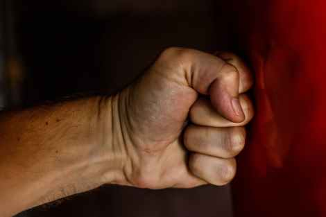 fist, anger, emotional charge. self awareness, angry, not peaceful, opposite of peace