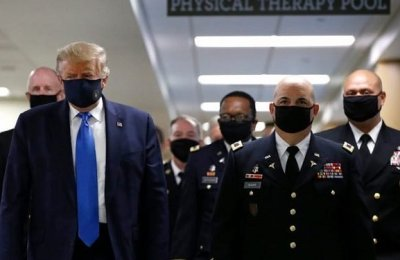 Trump Bow To Pressure, Finally Wears Mask In Public (Photos)