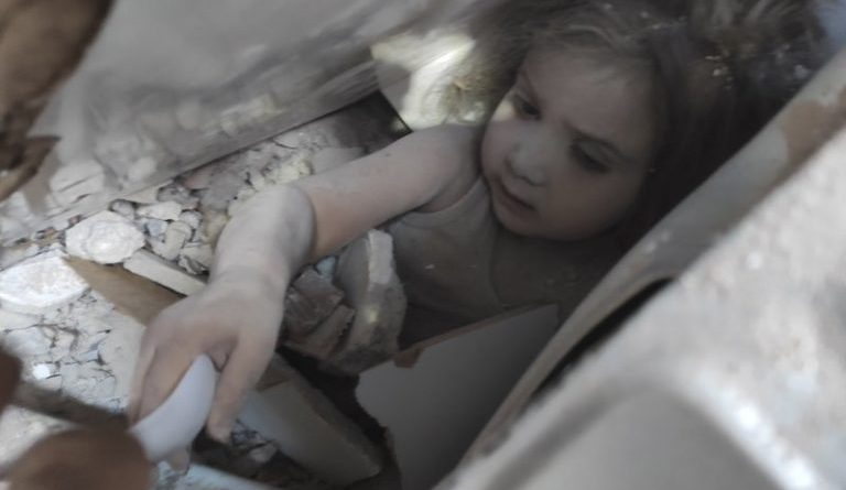Touching Photo Shows 3-Year-Old Pulled Alive From Under Rubble After 4 Days