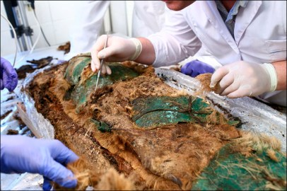 The body was covered with copper or bronze plates on the face, chest, abdomen, groin - and bonded with leather cords.' Pictures: Yamalo-Nenets regional Museum and Exhibition Complex