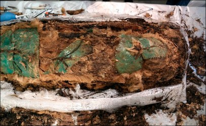 The body was covered with copper or bronze plates on the face, chest, abdomen, groin - and bonded with leather cords © Yamalo-Nenets regional Museum and Exhibition Complex