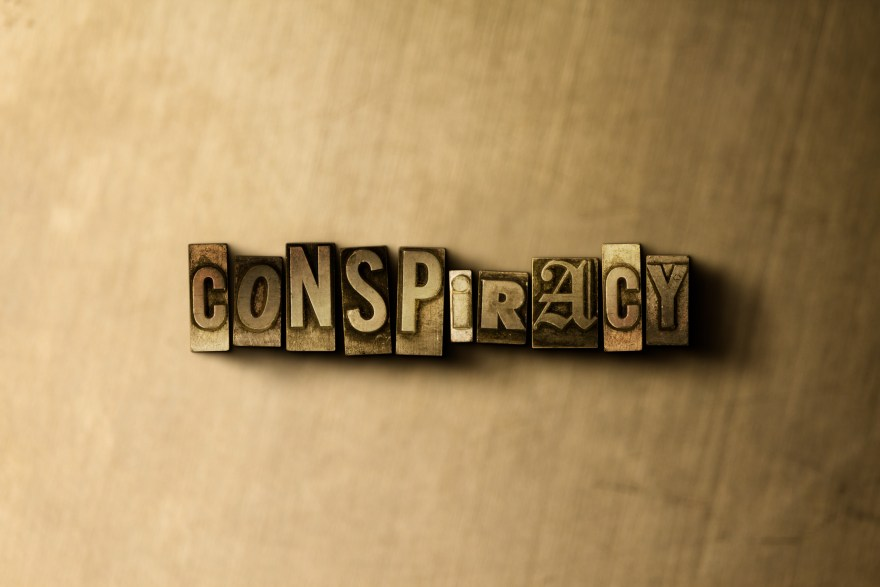 Conspiracy letters on wooden background image.jpeg