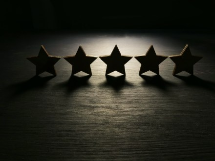 Five stars in the dark. Customer experience and satisfaction concept.