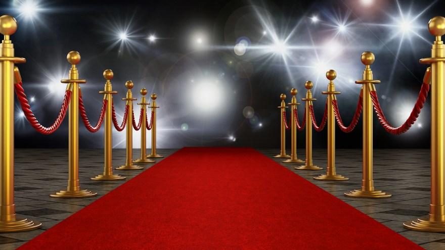 Red carpet and velvet ropes on gala night background. 3D illustration
