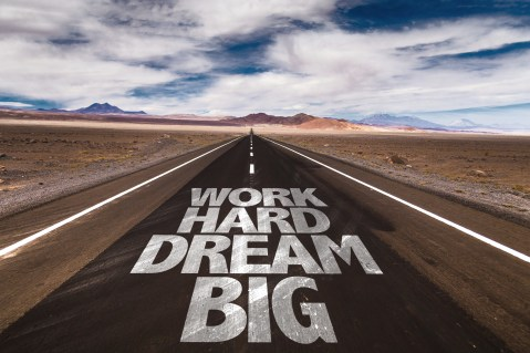 Work Hard Dream Big written on desert road