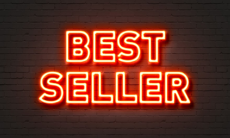 Bestseller neon sign on brick wall background.