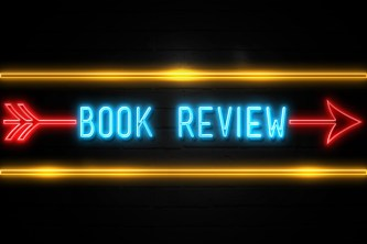 Book Review  - fluorescent Neon Sign on brickwall Front view