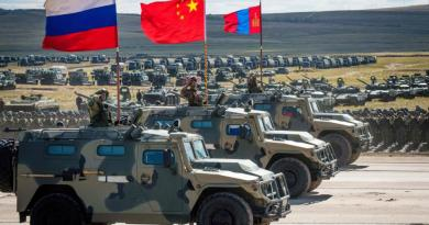 "WAR FOOTING – 300,000 Participate in Largest War Games Since Cold War- Russian and Chinese tanks tear up fields and choppers fill the skies. Putin Watches With ""Glee"" ..USA Media Responds – Demands the Arrest of Russian Social Media Hackers"