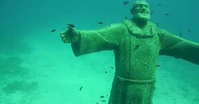 Padre Pio, 40 feet deep, awaits us with open arms