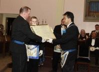 Wor. Privitera receives the Charter of Mystic Valley Lodge from the hands of the outgoing Master, Wor. Russell Wright.