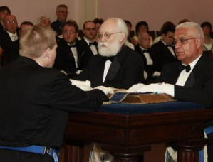 The elected officers for the 2013-2014 Masonic year recite their obligations.