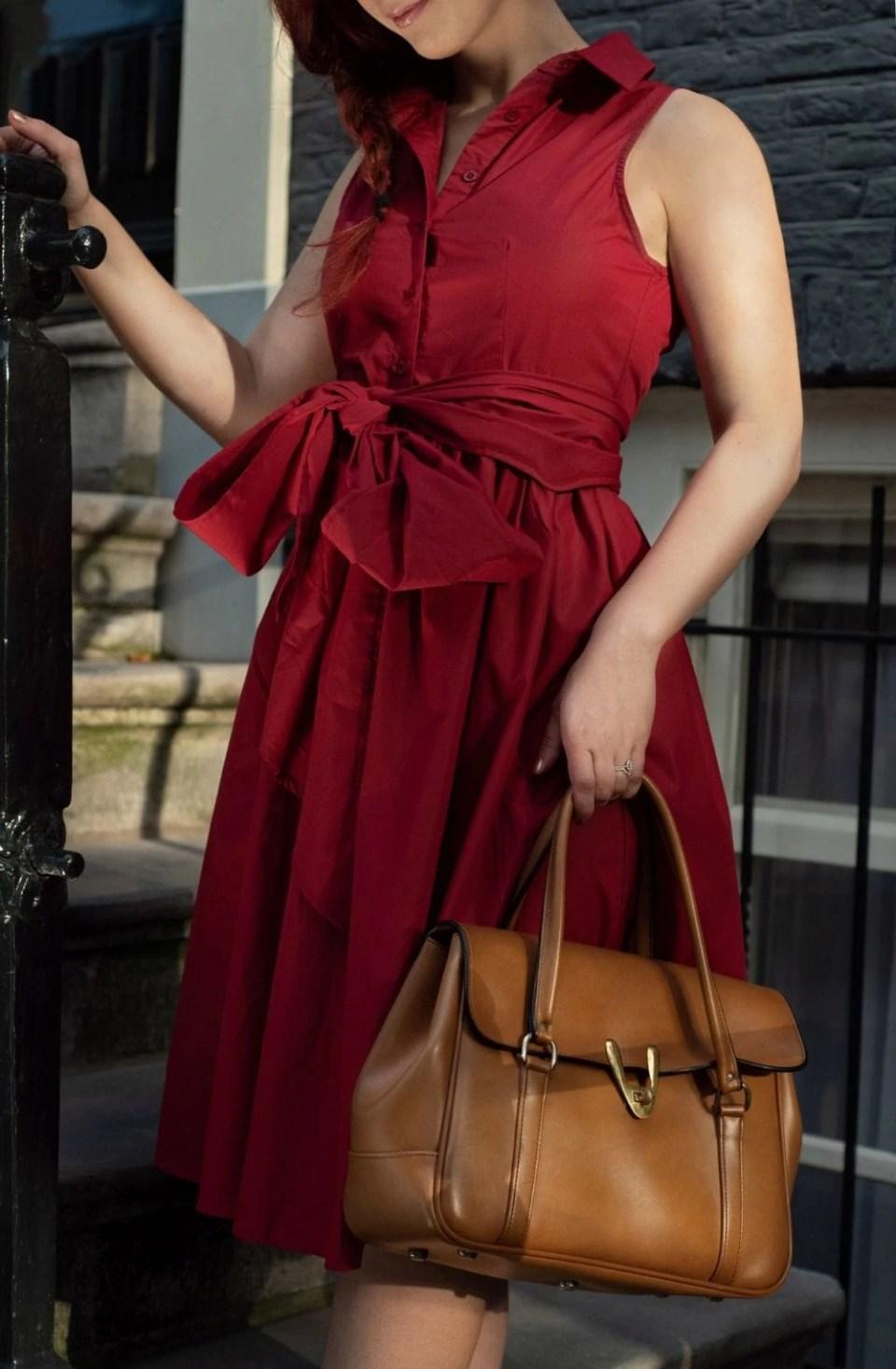 burgundy dress caramel bag