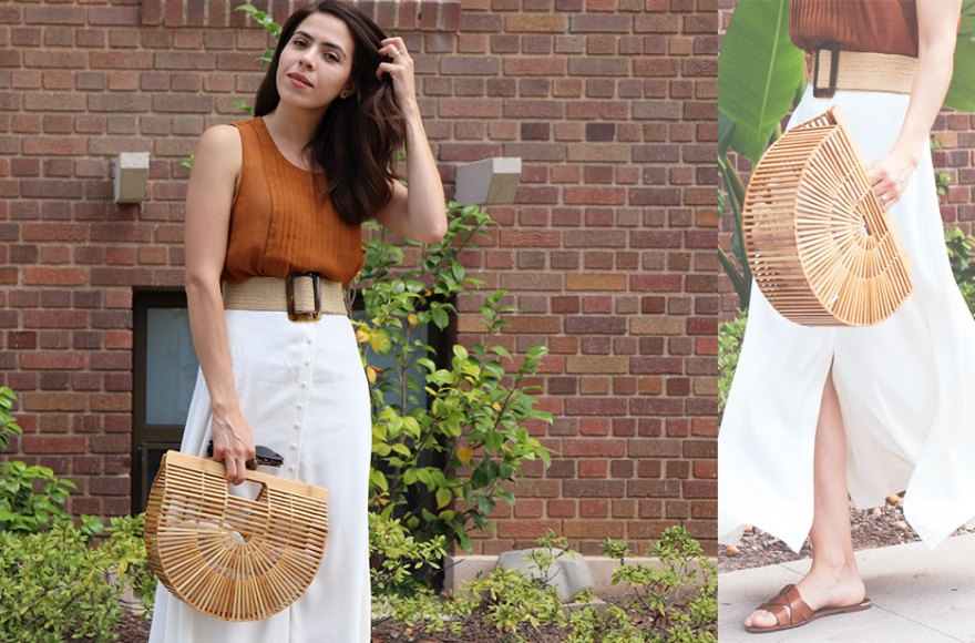 girl wearing a white midi skirt and brown top