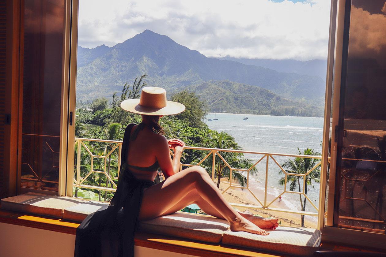 Girl-looking-out-window-kauai-views