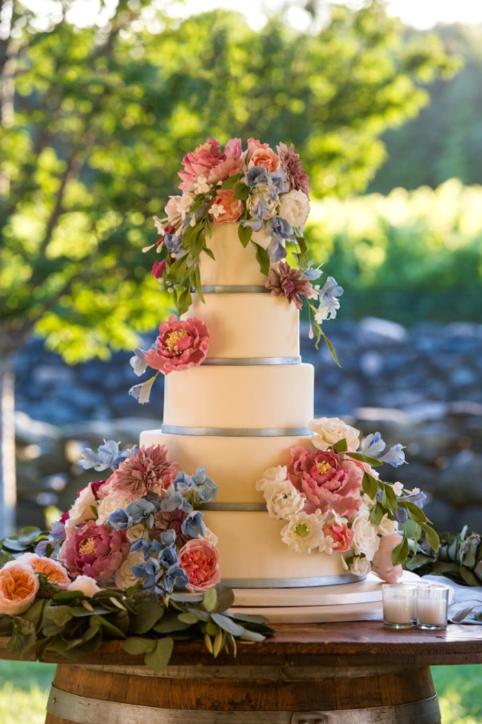 Colorful flowers wedding cake | See more: http://mysweetengagement.com/15-extraordinary-wedding-cakes-for-all-wedding-styles