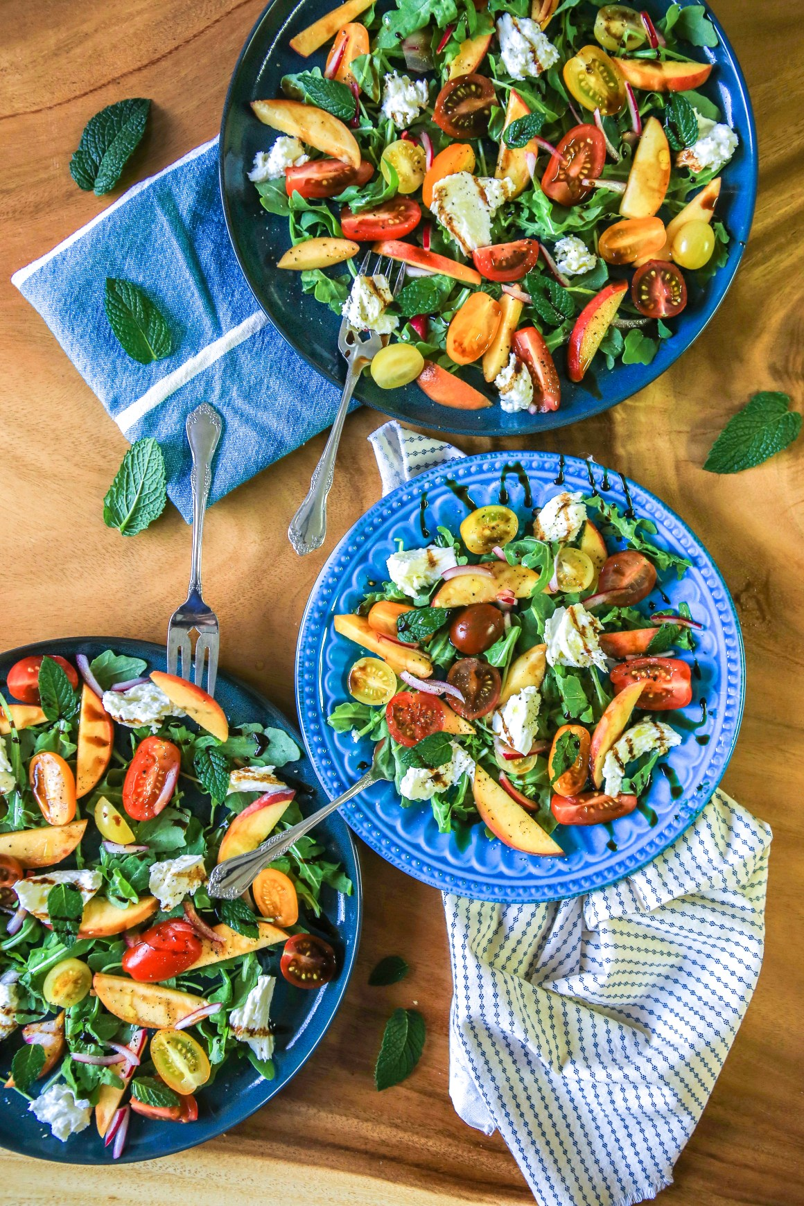 Fresh peach salad with arugula, mint, heirloom tomatoes and buffalo mozzarella