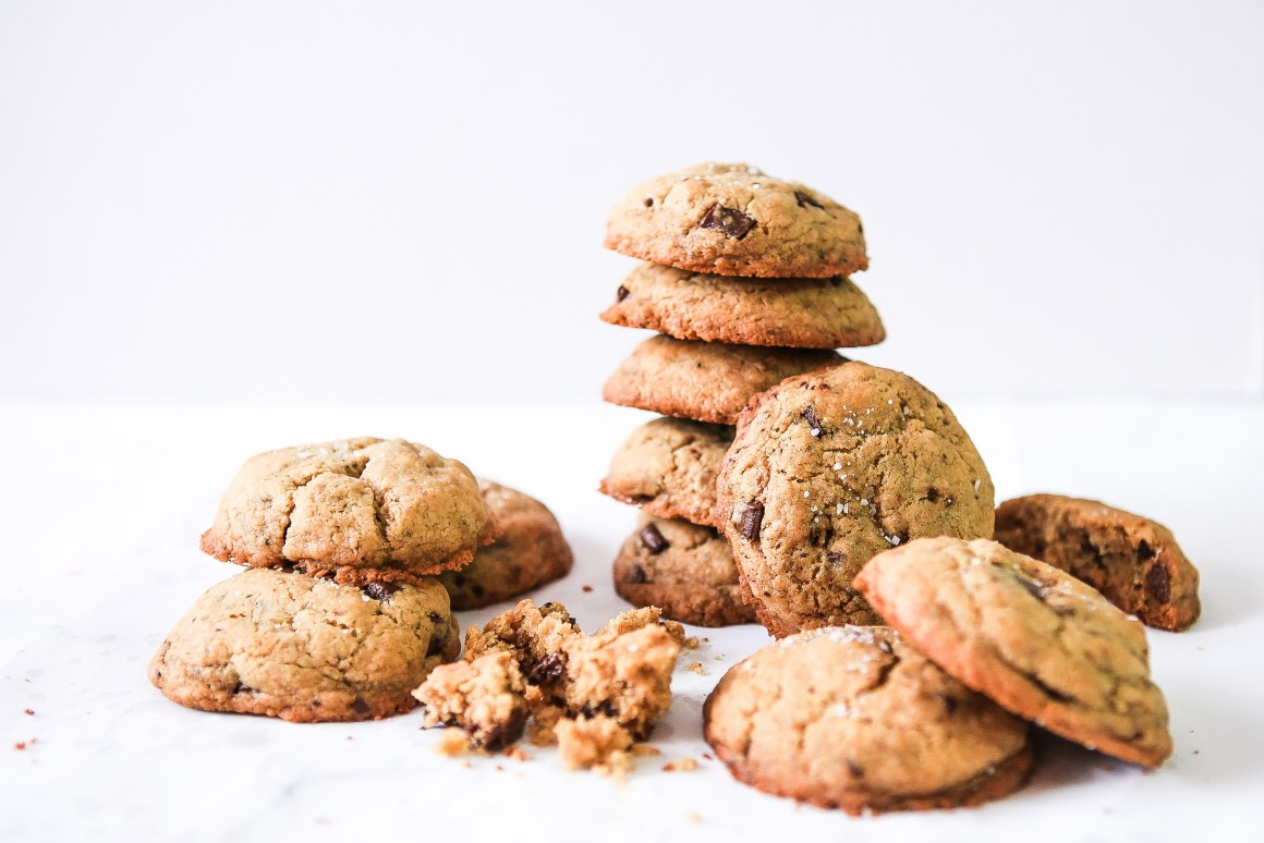 Chewy vegan and gluten-free salted tahini and dark chocolate chunk cookies