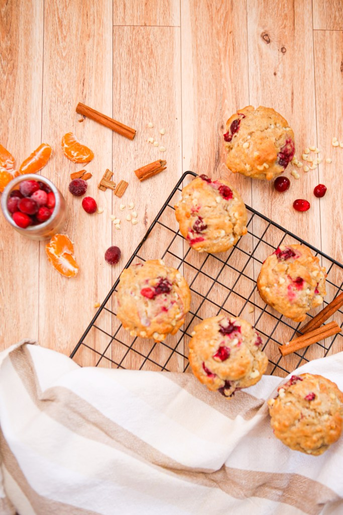 white chocolate cranberry orange muffins, the perfect holiday treat to share with family and friends | A hint of orange, tart cranberries and sweet white chocolate chips are a match made in muffin heaven | holiday baking | christmas recipe | christmas baking | muffins | healthyish | recipes to make with kids