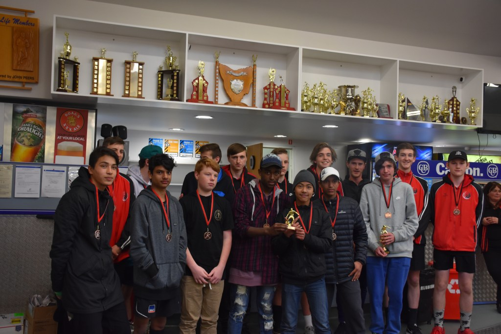 Picture of soccer participants with trophies