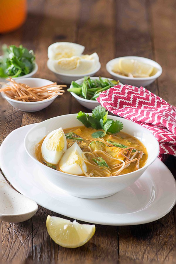 Khaw Suey is soup meal bowl inspired from Burmese noodle dish Ohn Khauk swe. The Burmese Khaw Suey Soup is vibrant in flavours, has lots of veggies and noodles cooked in coconut curry based soup.