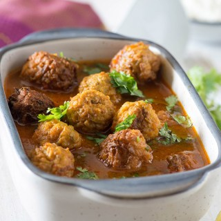 Lauki Kofta curry is tomato-based vegetarian curry from Indian cuisine. Lauki Kofta made with bottle gourd and gram flour are cooked in a light brothy but spicy curry.
