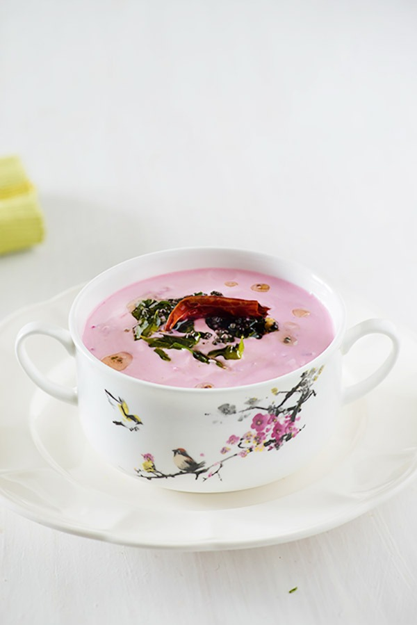 Beetroot raita is an Indian accompaniment or side dish for pulao and biryani. Grated beetroot is mixed in chilled yogurt or dahi with spices. Learn to make