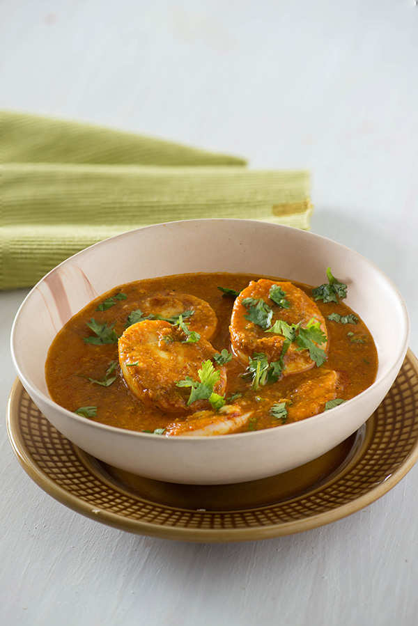 In Coconut masala egg curry, boiled eggs are cooked in roasted coconut gravy which is fragrant and thick. Coconut egg curry tastes absolutely best with either Malabar parotta, laccha paratha or tava roti. There are many versions of coconut egg curry, you can make Kerala style egg curry, you can make Sri Lankan egg curry in which gravy is made with thick coconut milk
