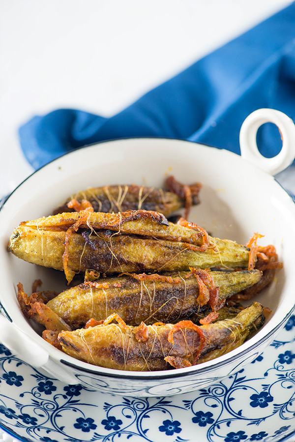 Punjabi style stuffed Karela recipe, simple and easy. In this North Indian stuffed Karela Sabzi recipe , the karela or bitter gourd is fried with fried onion and Indian spices.