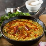 Punjabi Dal Palak is smoky spicy and super healthy dal recipe. Also known as spinach dal the dal palak recipe is easy way to add more health quotient to your everyday Indian meals. Tempering or tadka is what makes this super delicious.