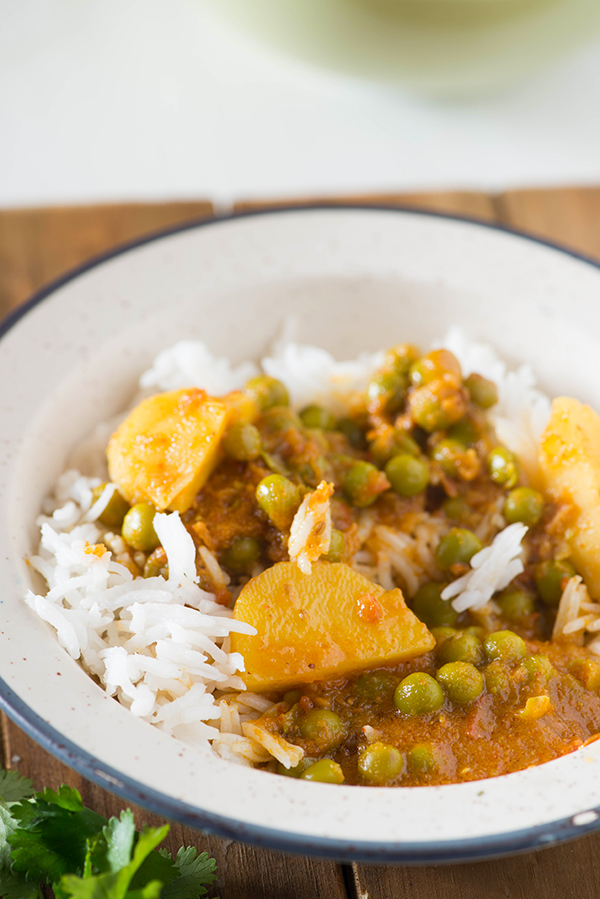 Punjabi  Aloo Matar Sabzi is flavourful and hearty curry, One of my favorite curry to serve with rice or Naan. Made with fresh winter peas and new potatoes this every day Indian curry is perfect solution when I am craving something comforting spicy and easy.