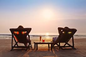 image of two empty chairs on a beach for people to relax in. Taxman can prepare and file your taxe so that you relax.