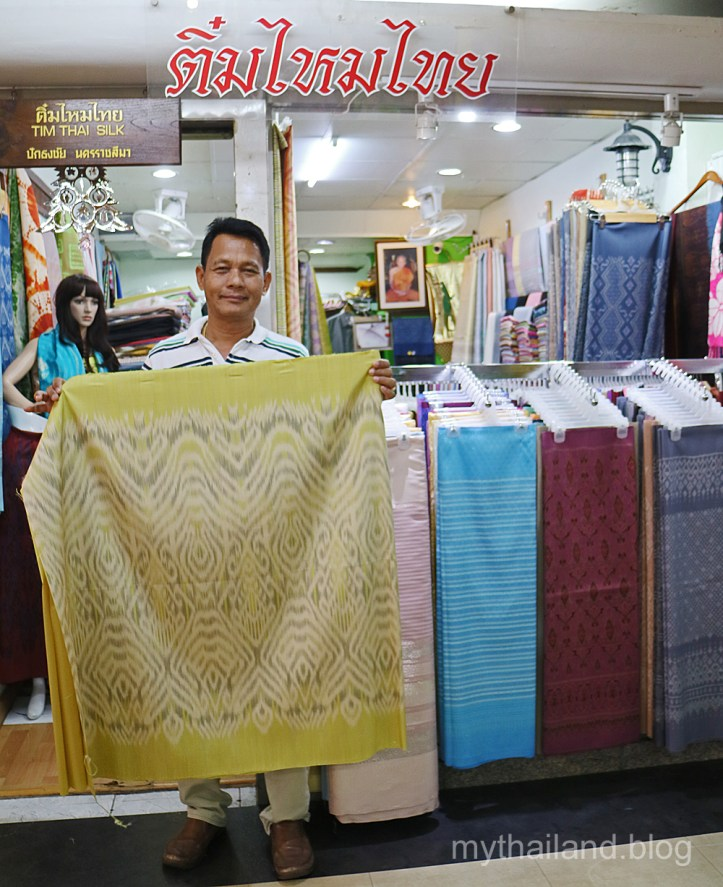 """A fabric store in the """"Silk Zone"""" in Bangkok. The owner onced worked as a sericulturist for Jim Thompson in Korat. I purchased the bolt of mudmee silk that's being displayed for $90. A decent price."""