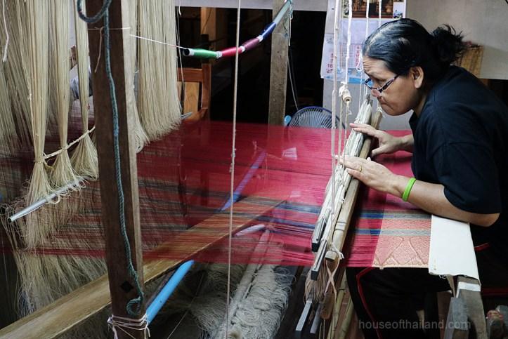 A silk weaver at work in Thailand
