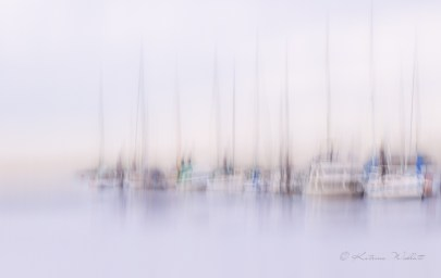 creative blur of yachts moored at dock