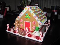 Front of Gingerbread House - with melting icing snowman and his fondant hat and scarf