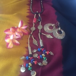 metal round ear rings and caravan soul neck chain from mayabazar