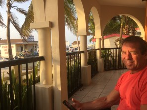 Mike enjoying the balcony at the Sunbreeze Suites at sunrise.