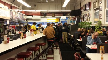 diner style interior with people buzzing about