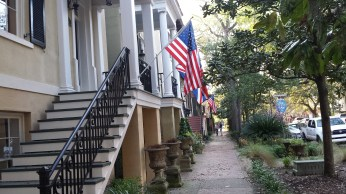 historic houses with USA flag hanging outside