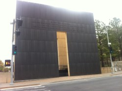a tall black wall with a doorway in it