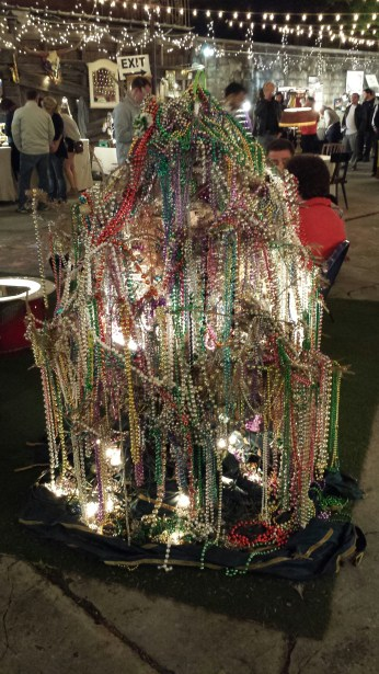Festive Mardi Gras bead tree