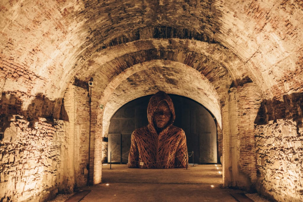 the wooden sculpture in the underground of the walls of lucca