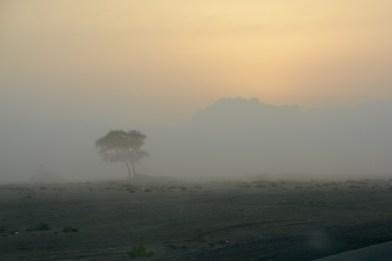 Sunrise behind the clouds, the lonely sabkha wastes of Ash Sharquiyah...