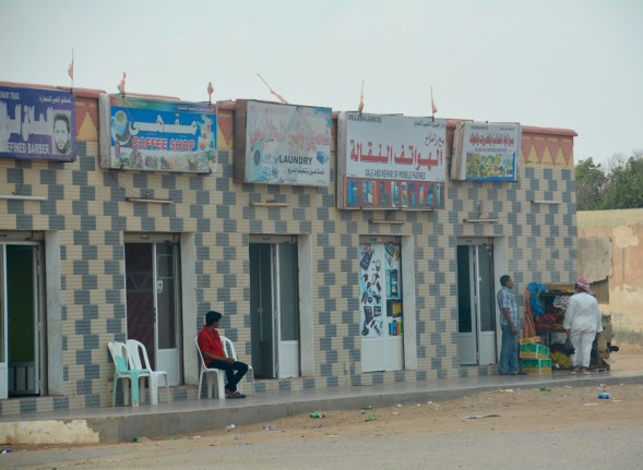 Typical small town shops in the remoter parts of coastal Oman...suspect there is a door shop close churning out the standard design!