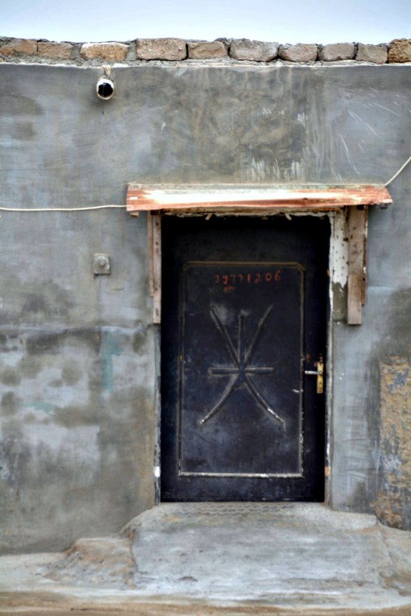 Neat little door , the symbol I think, associates with the police or military....