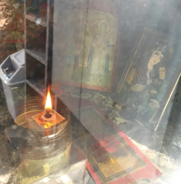 The candle and icons....I kept the reflected rubbish bin in as it shows that this little patch of land is carefully tended....