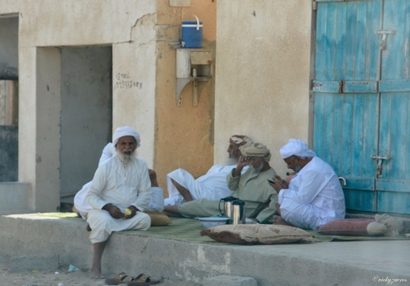 Streetside, turquoise green doors, and elders just resting in the shade...