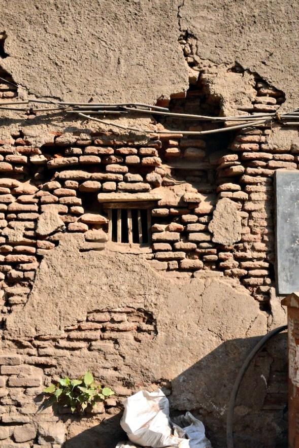 Tiny window amidst interesting thin bricks...